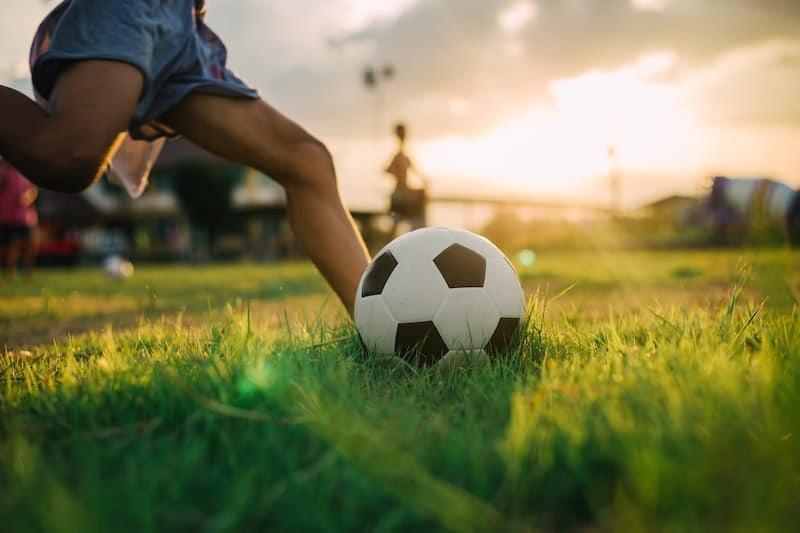 Little boy kicking soccer ball