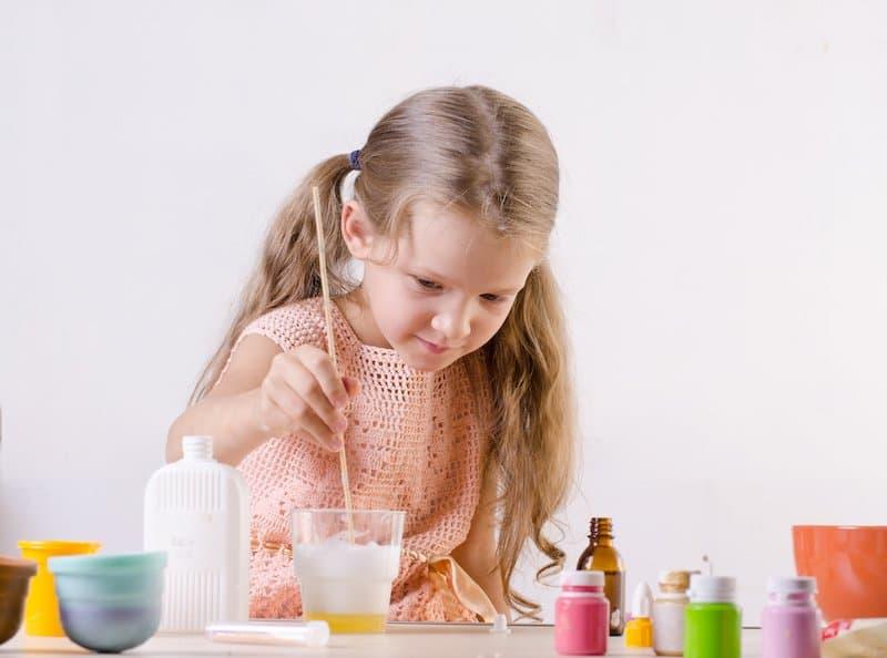 Little girl making slime toy