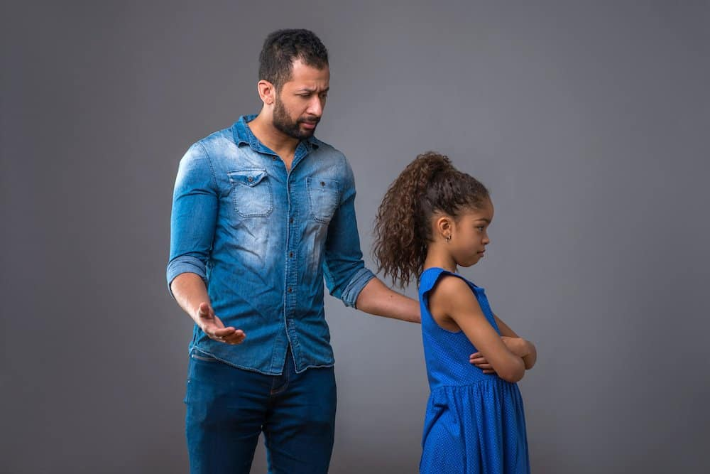 Father talking to upset daughter over blaming others
