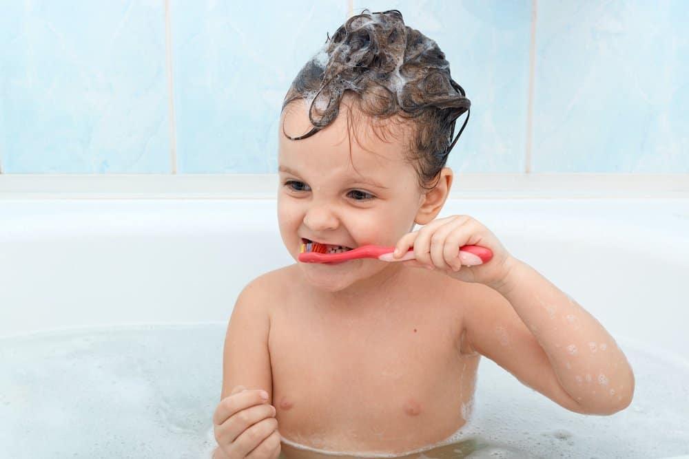 Kiddo brushing her teeth during nighttime bath routine