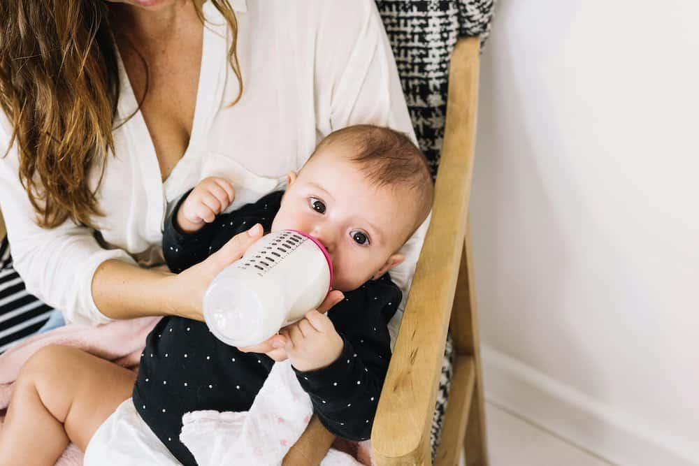 Why is my baby drinking less milk