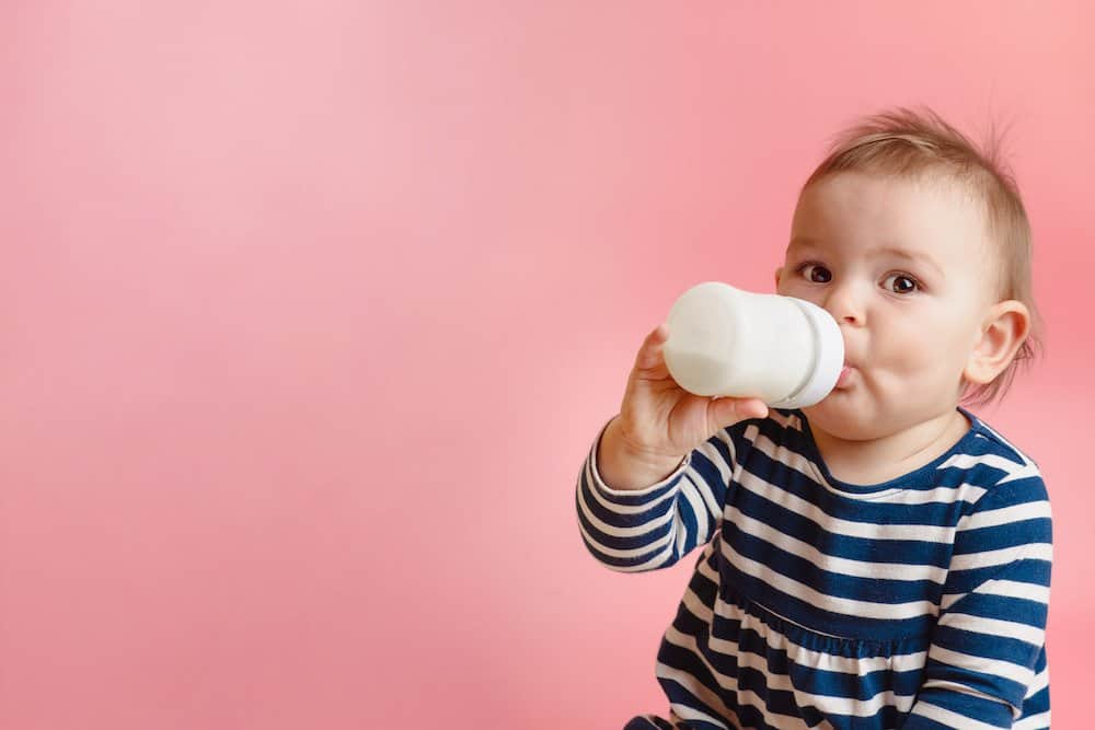 At what age do babies stop drinking formula/breastmilk?