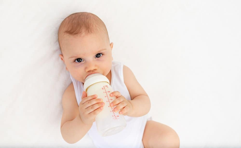Why baby drinking from bottle before bedtime is bad (hint, it's about their teeth!)