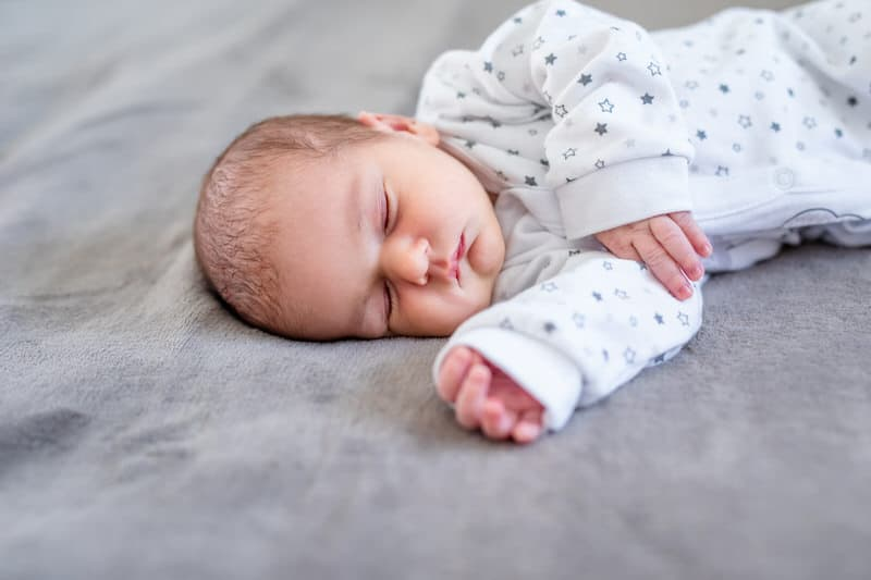 Is wheezing a sign of reflex in newborns?