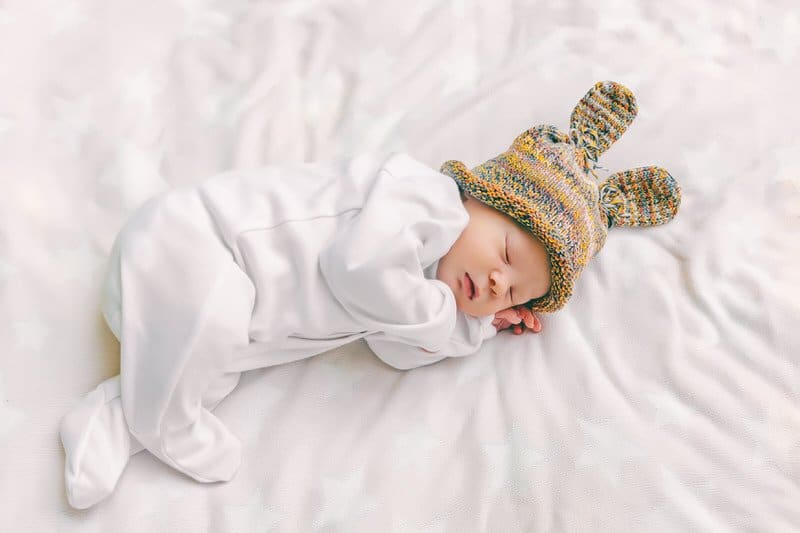 When to transition from swaddling to a wearable blanket