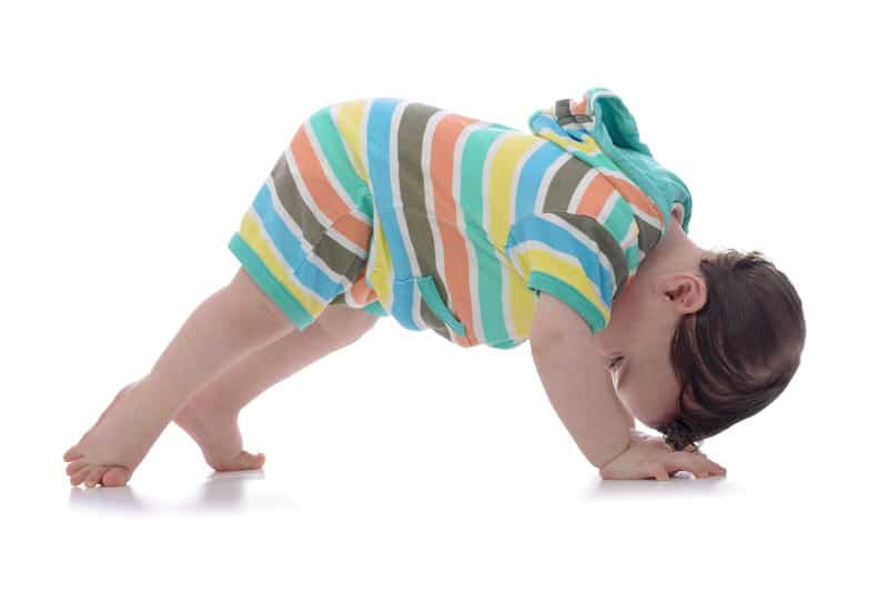 Crawling baby looking backwards