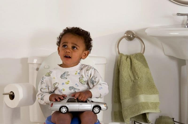 Why Is My Toddler Holding Poop While Potty Training - What Can I Do About It?