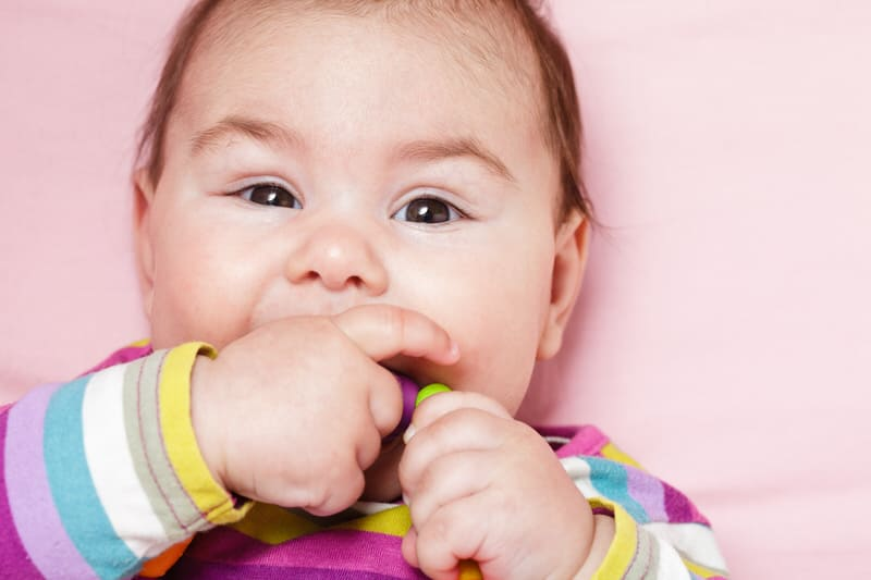 A 3 month baby who is teething will likely also bite his lip to relieve his itchy gums and tooth eruption.