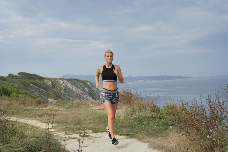 A young mom is running to get in her daily exercise, as well as to avoid getting varicose veins.
