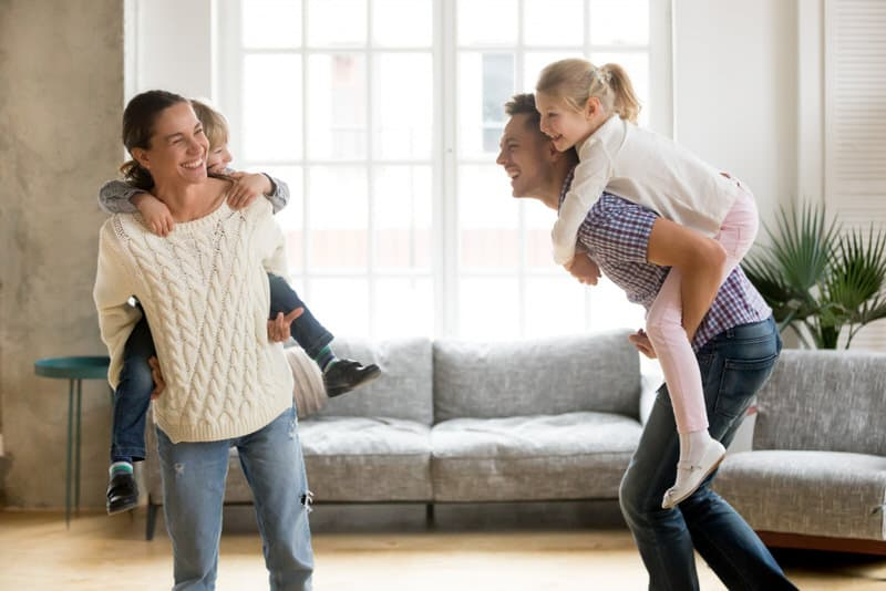 A son piggybacking on his mom, while a daughter is doing the same with her dad. Both might be showing signs of the Oedipus and Electra complex.