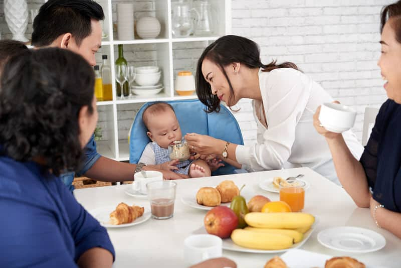 Mom is feeding her infant son. In China, the son preference lies deep in their culture.