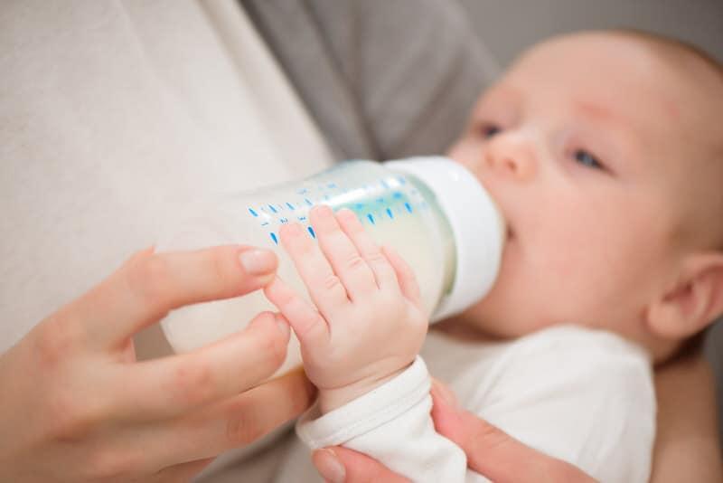 Mom is bottle-feeding her infant son.