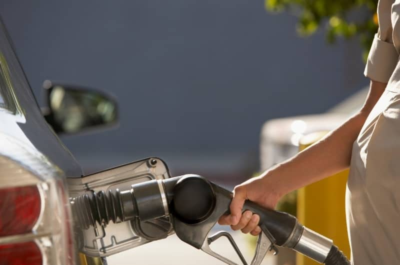 A young and recently pregnant woman is pumping gas at the gas station. She's worried about the effects of inhaling gas fumes during her pregnancy.