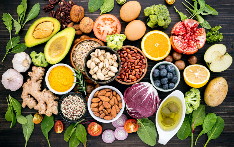 An assortment of high fiber foods that are safe and recommended for breastfeeding moms to eat to meeting their daily recommended fiber level.