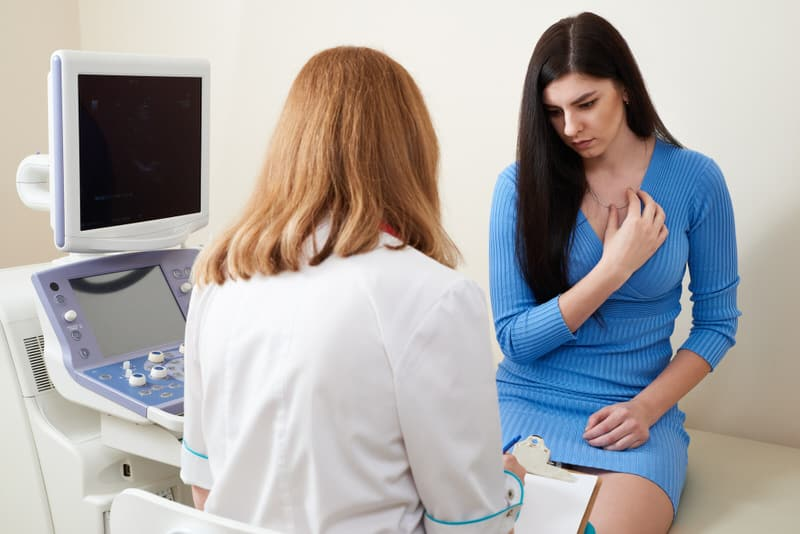 A young pregnant woman is getting checked at 16 weeks to make sure her symptoms are normal at that period of pregnancy.